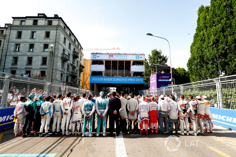 Drivers line up on the grid
