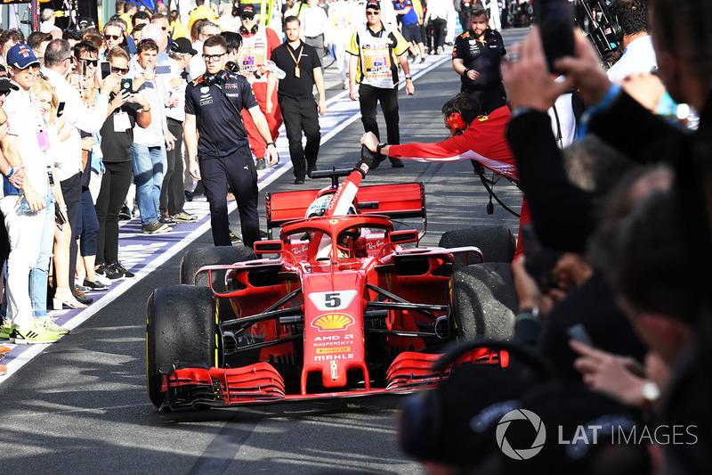 Race winner Sebastian Vettel, Ferrari SF71H celebrates as he arrives in parc ferme