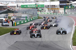 Lewis Hamilton, Mercedes AMG F1 W08, Max Verstappen, Red Bull Racing RB13, Sebastian Vettel, Ferrari SF70H, a locked-up Valtteri Bottas, Mercedes AMG F1 W08, Kimi Raikkonen, Ferrari SF70H, the rest of the pack at the start