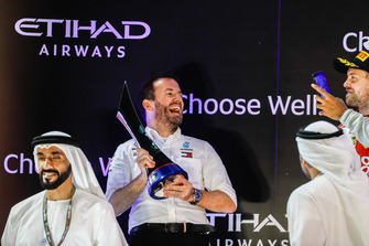 Bradley Lord, Communications Director, Mercedes AMG, receives the Constructors trophy on the podium