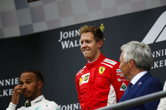 Lewis Hamilton, Mercedes AMG F1, 2nd position, and Sebastian Vettel, Ferrari, 1st position, on the podium