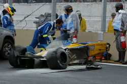 The remains of the Renault Renault F1 Team R23 of Fernando Alonso after his race ending crash