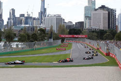 Kevin Magnussen, Haas F1 Team VF-18 leads Max Verstappen, Red Bull Racing RB14 at the start of the r