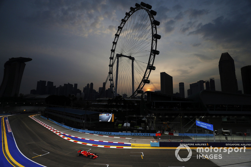 Sebastian Vettel, Ferrari SF71H, passes the Singapore Flyer ferris wheel