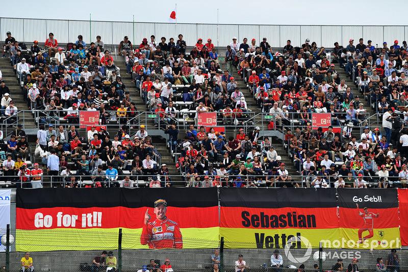 Sebastian Vettel, Ferrari fans and banners