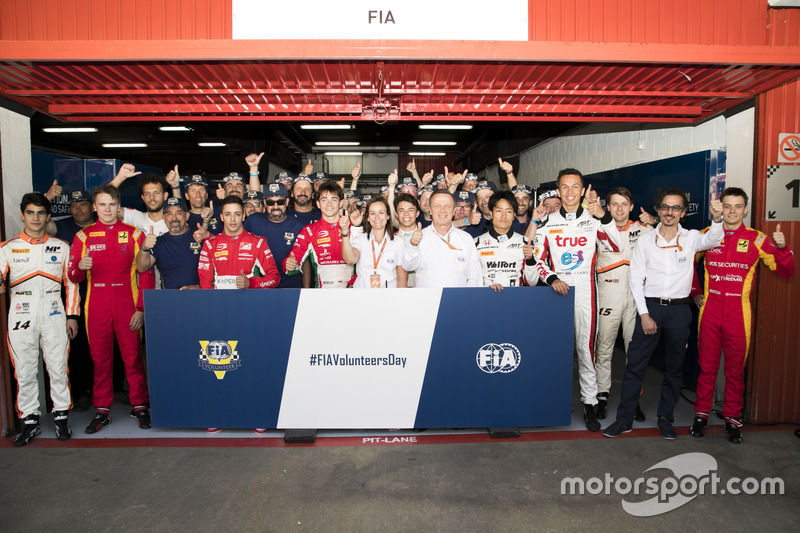 Drivers, officials and marshals gather for FIA Volunteers Day, which celebrates the volunteer work of marshals and organisers around the world that make motor racing possible