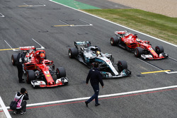The top-three line-up from qualifying stop on the start-finish straight. Pole winner Lewis Hamilton, Mercedes AMG F1, parks between Kimi Raikkonen, Ferrari and Sebastian Vettel, Ferrari
