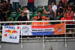Max Verstappen, Red Bull Racing fans and banners
