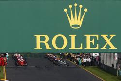 Lewis Hamilton, Mercedes AMG F1 W08, and Sebastian Vettel, Ferrari SF70H, prepare to lead the field away for the start