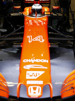 Fernando Alonso, McLaren, in cockpit, in garage, with helmet visor down