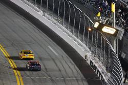 Kyle Busch, Joe Gibbs Racing Toyota takes the checkered flag under caution