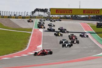 Kimi Raikkonen, Ferrari SF71H and Lewis Hamilton, Mercedes-AMG F1 W09 leads at the start of the race