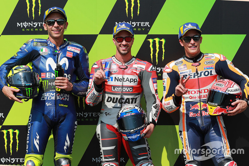 Pole sitter Andrea Dovizioso, Ducati Team, second place Valentino Rossi, Yamaha Factory Racing, third place Marc Marquez, Repsol Honda Team