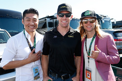 Actor Brian Tee, Shredder for the new TMNT movie and Greg Cipes, voice of Michelangelo on Nickelodeon's TMNT pose with Carl Edwards, Joe Gibbs Racing Toyota