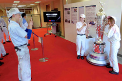 BorgWarner employees with the Borg-Warner Trophy