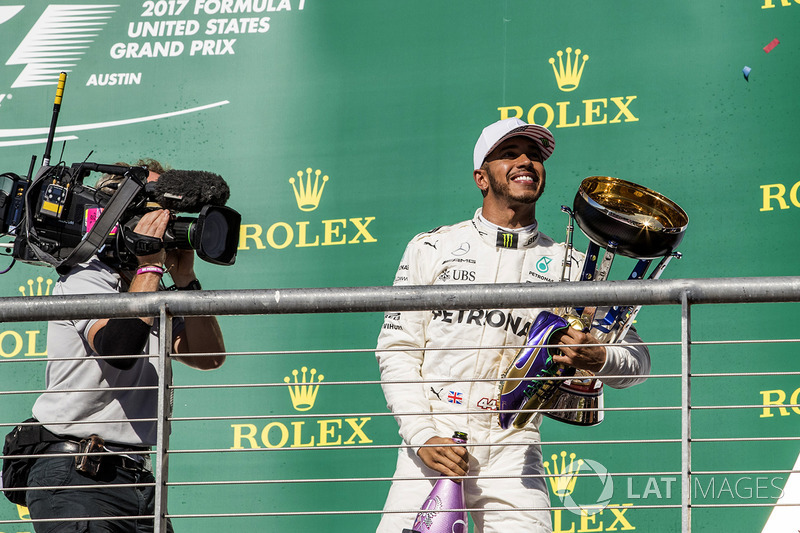 race winner Lewis Hamilton, Mercedes AMG F1 celebrates on the podium with the trophy, running shoes of Usain Bolt, the champagne