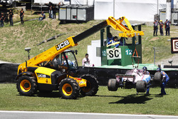 The car of Esteban Ocon, Sahara Force India F1 VJM10 is recovered after a crash