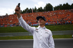 Max Verstappen, Red Bull, takes a photo, his Dutch fans in the background