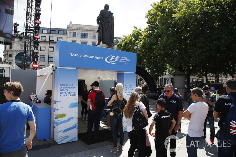 Fans queue at a TATA Communications kiosk