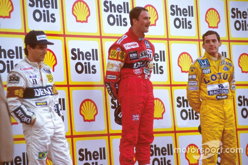 Подиум: Найджел Мэнселл, Williams, победитель, Нельсон Пике, Williams, второе место, и Айртон Сенна, Team Lotus, третье место