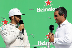 (L to R): Lewis Hamilton, Mercedes AMG F1 on the podium with Juan Pablo Montoya