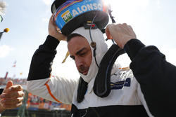 Fernando Alonso, McLaren, takes his helmet off on the grid