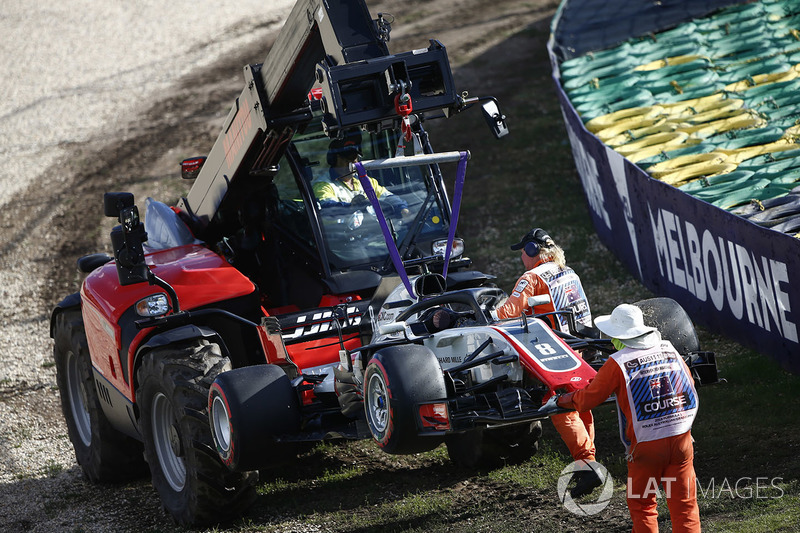 Marshals remove the car of Romain Grosjean, Haas F1 Team VF-18 Ferrari, from the circuit