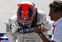 Mario Theissen, Director, BMW Motorsport, ganador Robert Kubica, BMW Sauber F1.08