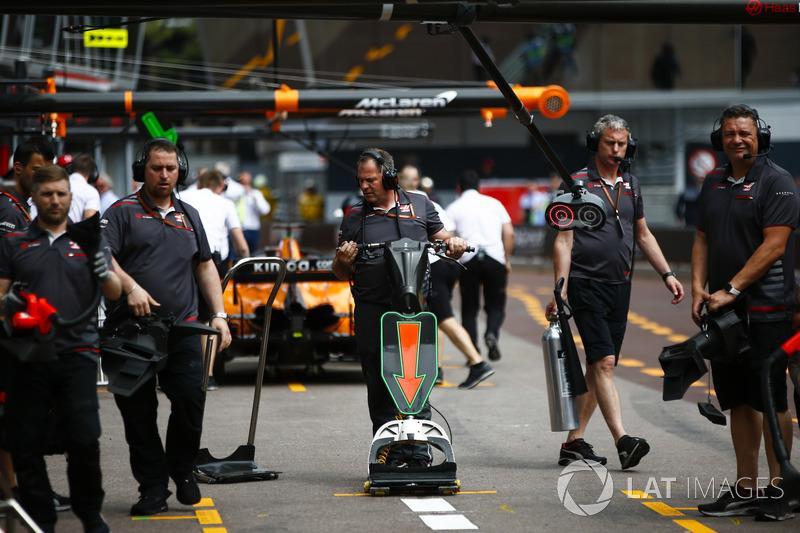Haas F1 Team engineers in the pit lane