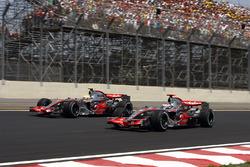 Lewis Hamilton, McLaren MP4-22 and Fernando Alonso, McLaren MP4-22