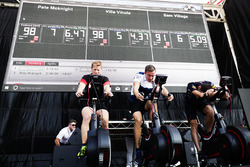 Team members take part in a cycling challenge on the F1 stage