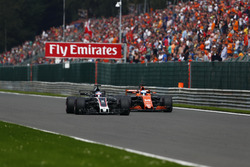 Romain Grosjean, Haas F1 Team VF-17, battles, Fernando Alonso, McLaren MCL32