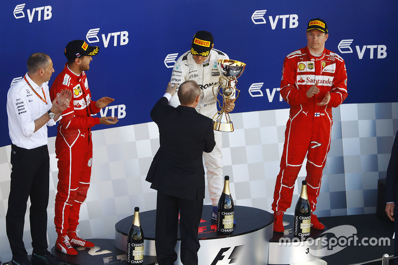 Race winner Valtteri Bottas, Mercedes AMG F1 from Russian President Vladimir Putin, alongside Second place Sebastian Vettel, Ferrari, Third place Kimi Raikkonen, Ferrari