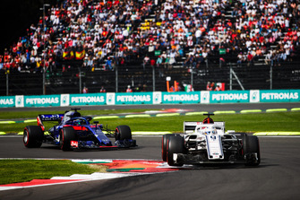 Marcus Ericsson, Sauber C37, leads Brendon Hartley, Toro Rosso STR13