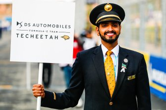 A Saudia Airlines representative holds the grid sign for DS Techeetah