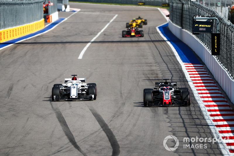 Romain Grosjean, Haas F1 Team VF-18, battles with Marcus Ericsson, Sauber C37