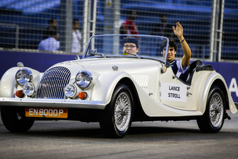 Lance Stroll, Williams Racing, rides in a Morgan on the drivers' parade