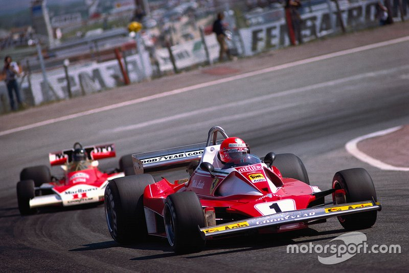 Niki Lauda, Ferrari 312T2, leads James Hunt, McLaren M23 Ford