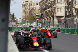 Max Verstappen, Red Bull Racing RB14 Tag Heuer, leads Kimi Raikkonen, Ferrari SF71H, Esteban Ocon, Force India VJM11 Mercedes, Carlos Sainz Jr., Renault Sport F1 Team R.S. 18, Sergio Perez, Force India VJM11 Mercedes, and the remainder of the field at the