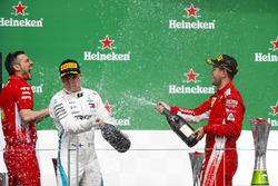 Valtteri Bottas, Mercedes AMG F1, 2nd position, and Sebastian Vettel, Ferrari, 1st position, spray C