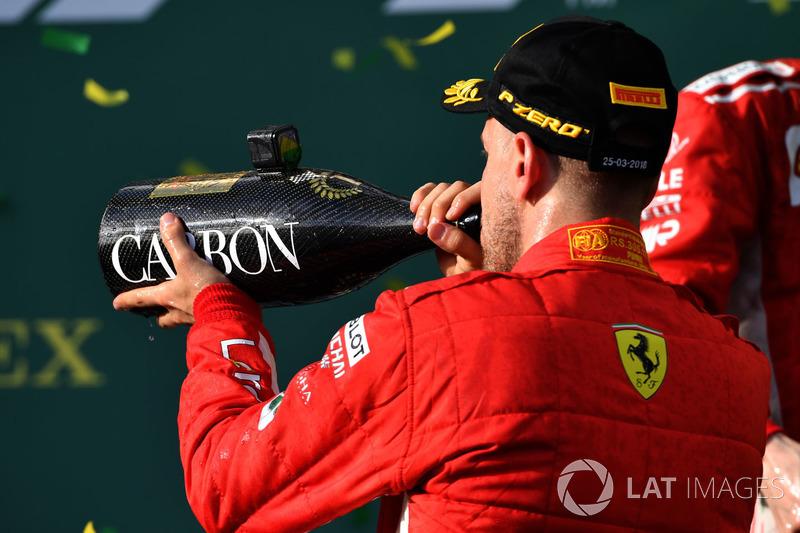 Sebastian Vettel, Ferrari celebrates with the champagne on the podium
