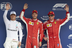 Top three Qualifiers, Valtteri Bottas, Mercedes AMG F1, pole sitter Sebastian Vettel, Ferrari, and Kimi Raikkonen, Ferrari