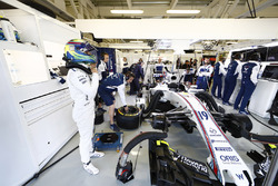 Felipe Massa, Williams FW40, prepares in the team's garage for FP3