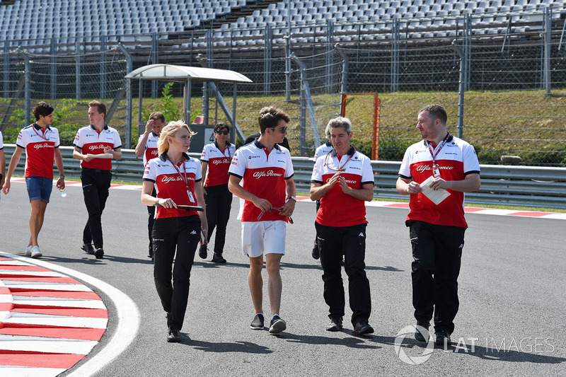 Charles Leclerc, Sauber walks the trackj with Ruth Buscombe, Sauber Race Strategist and Xevi Pujolar, Sauber Head of Track Engineering