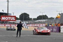 #85 Keating Motorsports Ferrari 488 GTE: Ben Keating, Jeroen Bleekemolen, Luca Stolz crosses the finish line at the checkered flag