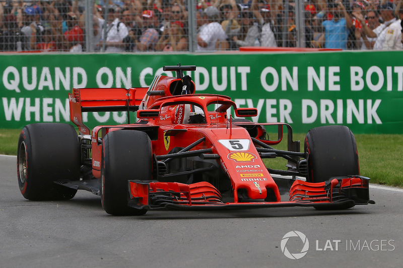 Race winner Sebastian Vettel, Ferrari SF71H waves at the end of the race