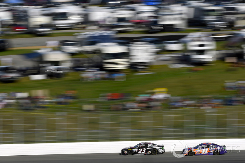 Corey LaJoie, BK Racing Toyota, Denny Hamlin, Joe Gibbs Racing Toyota