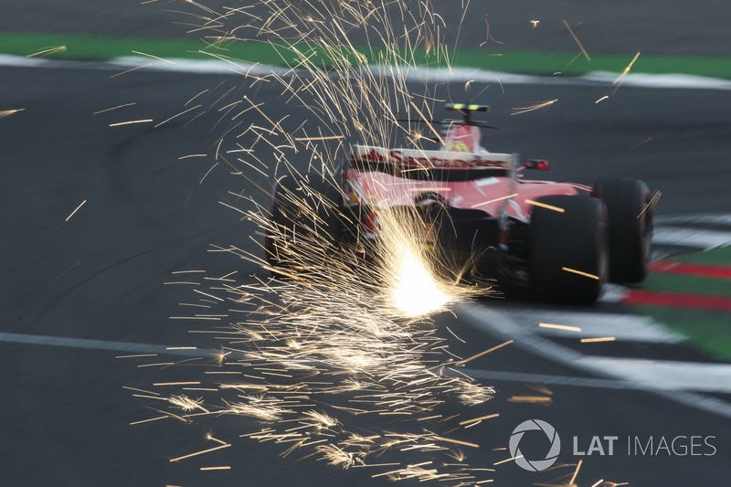 Sparks fly from the car of Kimi Raikkonen, Ferrari SF70H