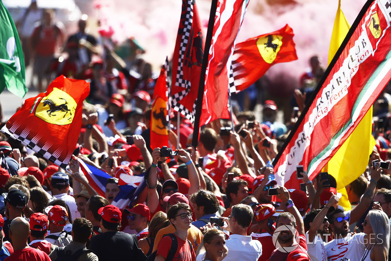 Fans celebrate after the race