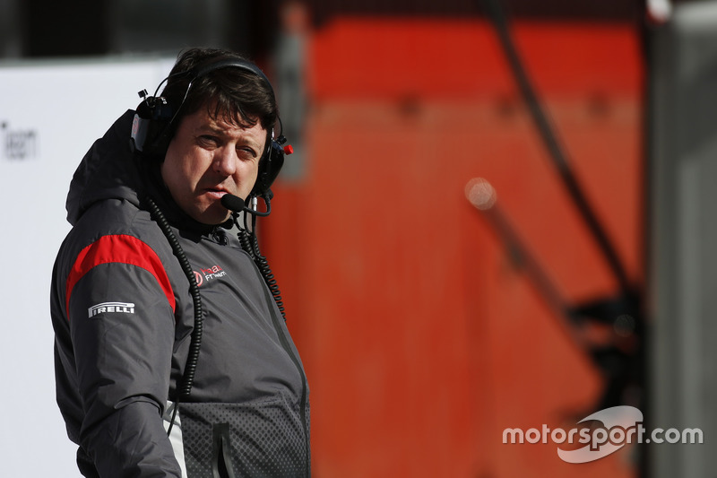 A Haas F1 team member at work